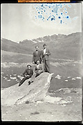 four friends posing with mountains in the background Pyrenees France 1950s 1960s