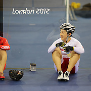 Chinese cyclists Guo Shuang (right) rests with a team mate during training at the Velodrome at Olympic Park, Stratford during the London 2012 Olympic games preparation.  London, UK. 20th July 2012. Photo Tim Clayton