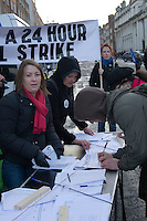Protesters sign a petition for a 24 hour national strike at a march in Dublin Ireland as part of a campaign organised by the Irish Congress of Trade Unions