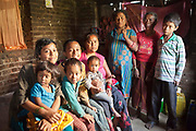 A Nepalese family in their home in Kathmandu, Nepal. The family is being supported by Voice for Children organisation which supports street children and those who are at risk of sexual abuse through educational and vocational training opportunities, health services and psychosocial counseling.