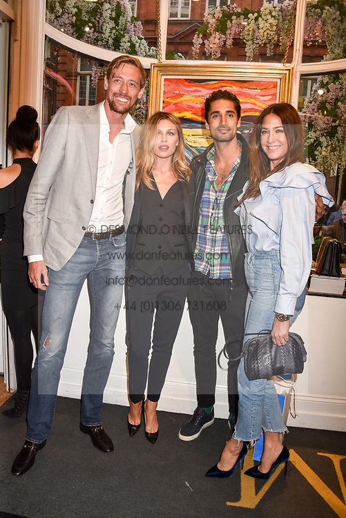 Left to right, Peter Crouch, Abbey Clancy, Hugo Taylor and Lisa Snowdon at a private view of work by Bradley Theodore entitled 'The Second Coming' at the Maddox Gallery, 9 Maddox Street, London England. 19 April 2017.