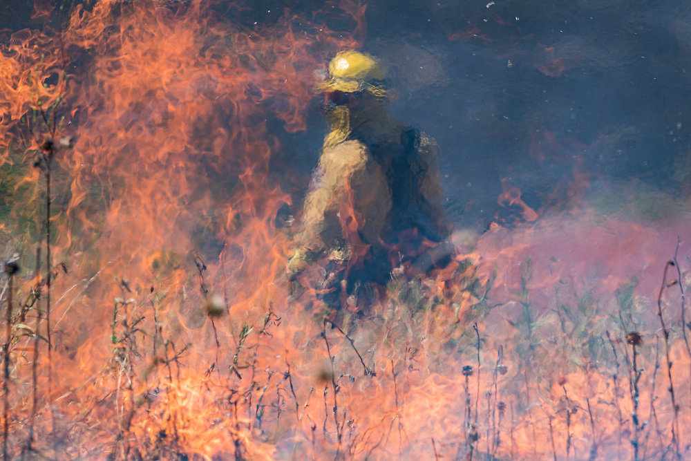 An inmate fire crew fights the River Fire near Salinas, Calif. on Aug. 16, 2020.