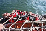 Een 'drenkeling' wordt aan boord gehaald van de KNRM reddingboot.<br /> <br /> A 'drowning man' is rescued by the lifeboat John Paul of the KNRM (Royal Dutch Rescue Organization) in Noordwijk aan Zee.