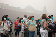 Moscow, Russia, 07/08/2010. .A tourist group in Red Square wear protective masks in the worst smog so far in the record high temperatures of the continuing heatwave. Peat and forest fires in the countryside surrounding Moscow have resulted in the Russian capital being blanketed in heavy smog.