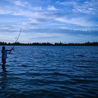 Huahine, French Polynesia, Maeva, fisherman at sunset