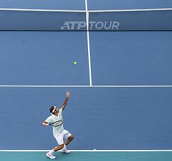 March 25, 2019 - Miami Gardens, FL, USA - Roger Federer, of Switzerland, serves against Filip Krajinovic, of Serbia, during their match at the Miami Open tennis tournament on Monday, March 25, 2019 at Hard Rock Stadium in Miami Gardens, Fla. (Credit Image: © Matias J. Ocner/Miami Herald/TNS via ZUMA Wire)