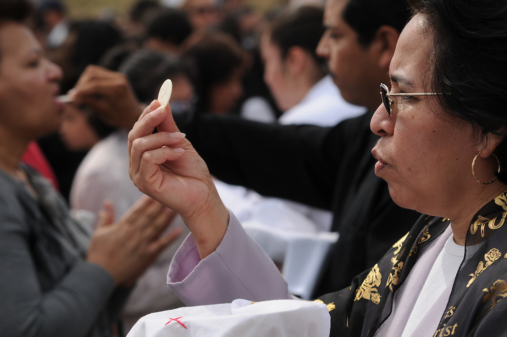 Several thousand Catholics receive communion during an outdoor Good Friday Mass at Most Blessed Trinity Parish in Waukegan.