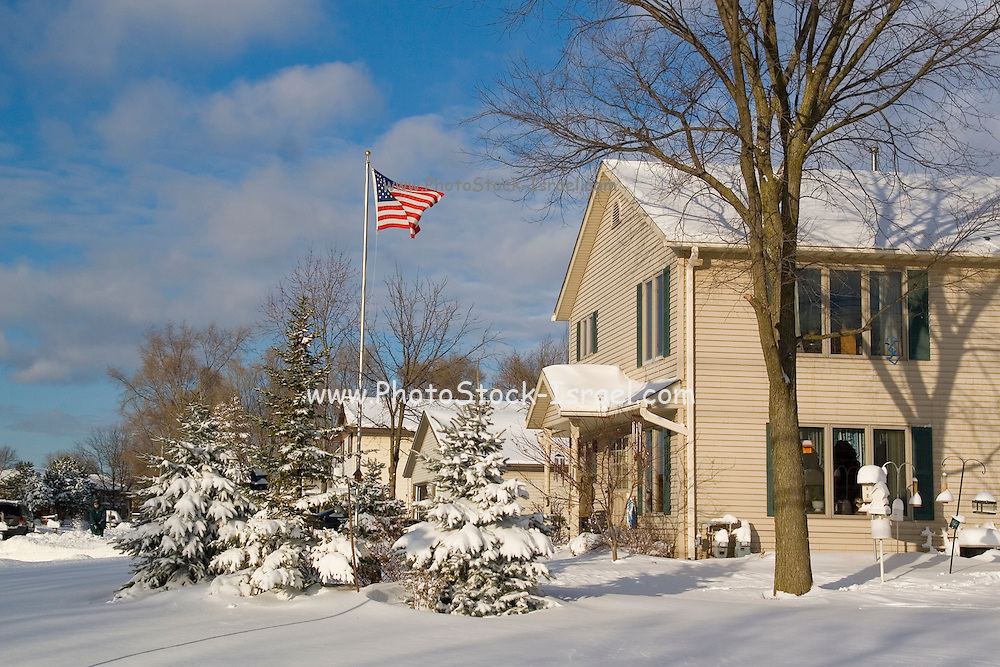 Wisconsin USA, Milwaukee American flag blowing in the snow covering the streets December 2006
