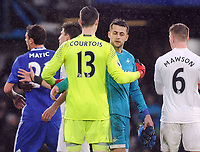 Football - 2016 / 2017 Premier League - Chelsea vs. Swansea City<br /> <br /> Lukasz Fabianski of Swansea is consoled by Chelsea goalkeeper Thibaut Courtois at the final whistle after he let the ball go under his body for Pedro's 2nd goal for chelsea at Stamford Bridge.<br /> <br /> COLORSPORT/ANDREW COWIE