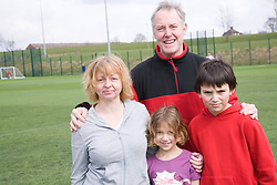 Active family on a playing field at their local leisure centre,