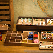 Colored pins and thread used to mark the large wall maps at the Churchill War Rooms in London. The museum, one of five branches of the Imerial War Museums, preserves the World War II underground command bunker used by British Prime Minister Winston Churchill. Its cramped quarters were constructed from a converting a storage basement in the Treasury Building in Whitehall, London. Being underground, and under an unusually sturdy building, the Cabinet War Rooms were afforded some protection from the bombs falling above during the Blitz.