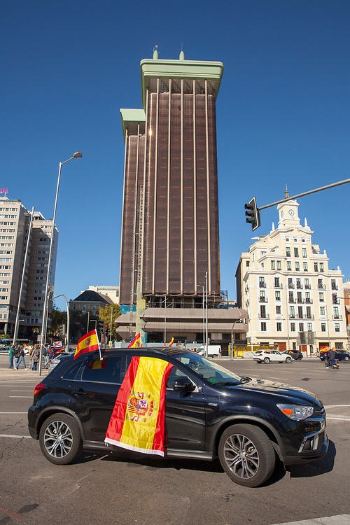 MADRID, SPAIN - OCTOBER 12: A car drives by Plaza de Colón (Clumbus Square) during Spain's National Day on October 12, 2020 in Madrid, Spain. This year the traditional Spanish National Day military parade alongside the Paseo de la Castellana in Madrid has been canceled due to the Covid-19 pandemic and replaced by a more discreet event at the Royal Palace. (Photo by Miguel Pereira/Getty Images)