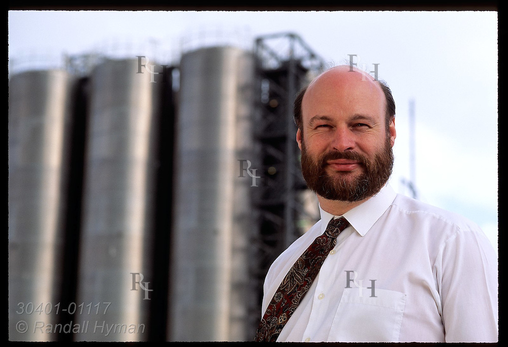 Jim Houston, Provox rep for Fisher Controls, stands by steel silos @ BP Chemicals;Grangemouth Scotland