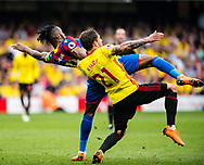 Watford (21) Kiko Femenía, Wilfried Zaha (11) of Crystal Palace  during the Premier League match between Watford and Crystal Palace at Vicarage Road, Watford, England on 21 April 2018. Picture by Sebastian Frej.