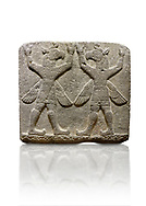 """Picture & image of Hittite relief sculpted orthostat stone panel of Herald's Wall Basalt, Karkamıs, (Kargamıs), Carchemish (Karkemish), 900-700 B.C. Bird-headed, winged figures of human body. Anatolian Civilisations Museum, Ankara, Turkey.<br /> <br /> These figures are called as """"Winged Griffin Demons"""". Embossing is constructed symmetrically. Their hands are on their heads. It is assumed that they carry the heavens. <br /> <br /> Against a white background. .<br />  <br /> If you prefer to buy from our ALAMY STOCK LIBRARY page at https://www.alamy.com/portfolio/paul-williams-funkystock/hittite-art-antiquities.html  - Type  Karkamıs in LOWER SEARCH WITHIN GALLERY box. Refine search by adding background colour, place, museum etc.<br /> <br /> Visit our HITTITE PHOTO COLLECTIONS for more photos to download or buy as wall art prints https://funkystock.photoshelter.com/gallery-collection/The-Hittites-Art-Artefacts-Antiquities-Historic-Sites-Pictures-Images-of/C0000NUBSMhSc3Oo"""