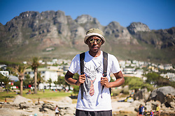 Zimbabwean hipster at Camps Bay, Cape Town, South Africa. 08/01/15. Photo by Andrew Tallon