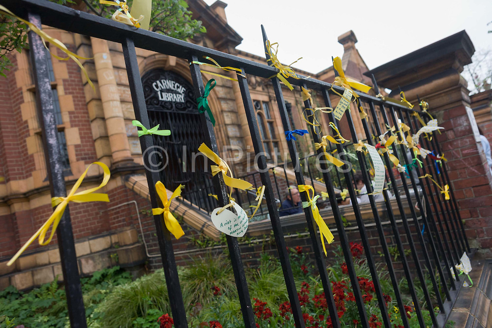 Campaigners locked out of the closed Carnegie Library have tied yellow ribbons and messages to the railings in Herne Hill, south London on 7th May 2016. For ten days, members of the community in the south London borough occupied their important resource for learning and social hub for the weekend. But after a long campaign by locals, Lambeth have gone ahead and closed the librarys doors because they say, cuts to their budget mean millions must be saved. A gym is planned to replace the working library and while some of the 20,000 books on shelves will remain, no librarians will be present to administer it. London borough's budget cuts mean four of its 10 libraries will either close, move or be run by volunteers.
