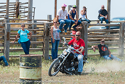 Mike Halachik rides Hilary Goloda's Sportster in the Spur Creek Ranch rodeo arena on highway 79 north of Sturgis on the Michael Lichter - Sugar Bear ride during the annual Sturgis Black Hills Motorcycle Rally. SD, USA. August 3, 2014.  Photography ©2014 Michael Lichter.