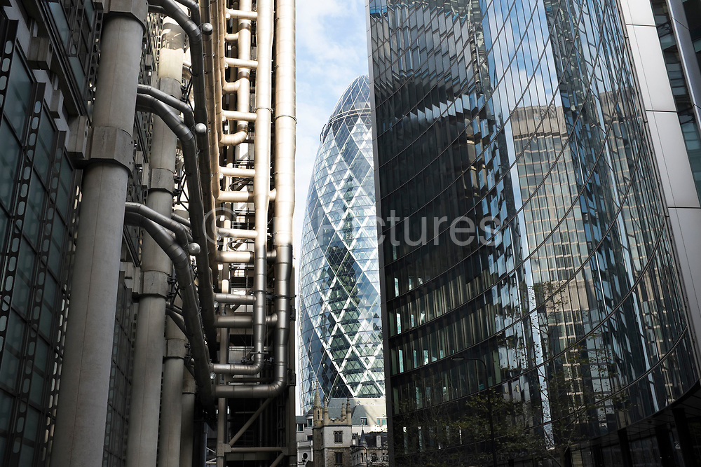 The Lloyds Building reflected in the modern architecture of a glass building opposite in the City of London, UK. This small area is well known for it's ground breaking architectural design.