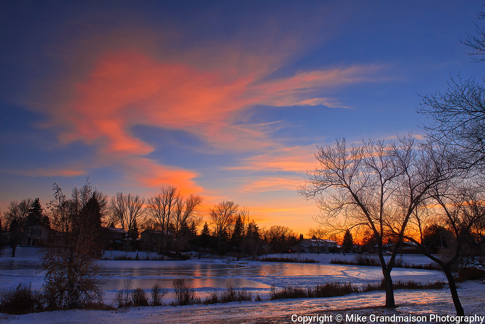 Clouds at sunset in urban park. Southdale neighbourhood<br />Winnipeg<br />Manitoba<br />Canada
