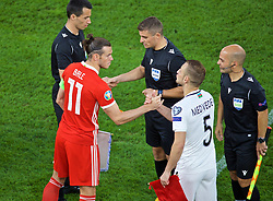 CARDIFF, WALES - Friday, September 6, 2019: Wales' captain Gareth Bale shakes hands with Azerbaijan's captain Maksim Medvedev before the UEFA Euro 2020 Qualifying Group E match between Wales and Azerbaijan at the Cardiff City Stadium. (Pic by Paul Greenwood/Propaganda)