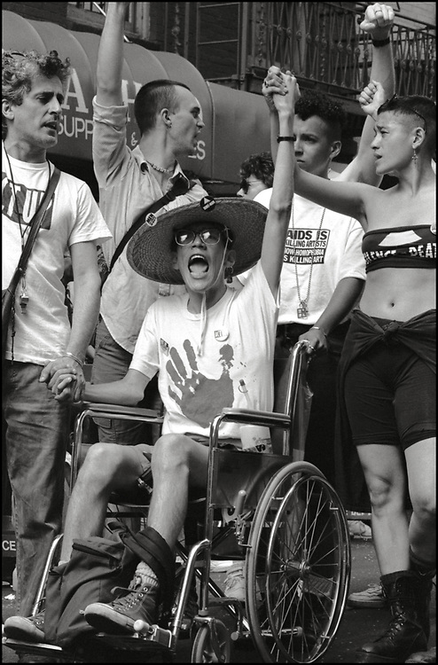 Anthony Ledesma, Lola Flash and Julie Tolentino and other members of ACT UP march in the Gay Pride Parade in New York City in June, 1990.
