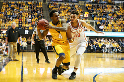 Jan 20, 2018; Morgantown, WV, USA; West Virginia Mountaineers guard Daxter Miles Jr. (4) and Texas Longhorns guard Eric Davis Jr. (10) collide in the corner during the second half at WVU Coliseum. Mandatory Credit: Ben Queen-USA TODAY Sports
