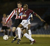 Photo Aidan Ellis.<br /> Burnley v Sunderland.<br /> Coca-Cola Championship.<br /> Turf Moor, Burnley.<br /> 04/03/2005.<br /> Sunderland's Michael Bridges and Burnley's Frank Sinclair battle for possesion