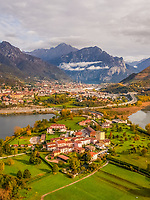 Aerial view of small city surrounding by tall mountains, Civate, Italy.