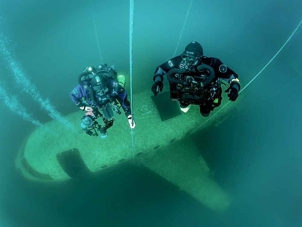 Chest Mount and KISS Spirit rebreather divers ascend from the Aircraft Challenger 600 at Dutch Springs Quarry in Bethlehem, Pennsylvania