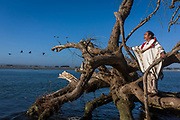 Lorenzo Ayallapan Cayuleo, 81 also known as El hombre Pájaro, Birdman. Lorenzo claims to speak and understand 60 different bird languages. In the Mapuche world he is aknowledged as a sage and guardian of his peoples ancestral  culture. Seen here at his favourite spots where four rivers meet the Pacific Ocean in the bay of Puerto Saavedra in Araucanía. He claims it to be a place of great energy which makes it easy to listen to  the four sounds of life:  the earth, the sea, the wind and the sound of the trees. He is a master imitator of all these diverse sounds, Puerto Saavedra, Chile. February 13, 2018.