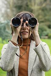 Woman in Park Looking through Binoculars