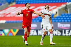 Kieffer Moore of Wales and Kristian Dimitrov of Bulgaria - Rogan/JMP - 06/09/2020 - FOOTBALL - Cardiff City Stadium - Cardiff, Wales - Wales v Bulgaria - UEFA Nations League Group B4.