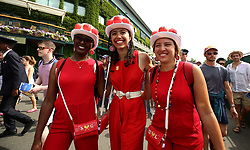 Roger Federer fans show their support at the start of day seven of the Wimbledon Championships at the All England Lawn Tennis and Croquet Club, Wimbledon.