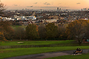 Courting couple in park overlooking the city during the second national coronavirus lockdown on 19th November 2020 in London, United Kingdom. The new national lockdown is a huge blow to the economy and for individuals who were already struggling, as Covid-19 restrictions are put in place until 2nd December across England, with all non-essential businesses closed.