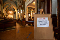 Signage informs parishioners of the social distancing measures inside Sacred Heart Church in Laconia.  (Karen Bobotas/for the Laconia Daily Sun)