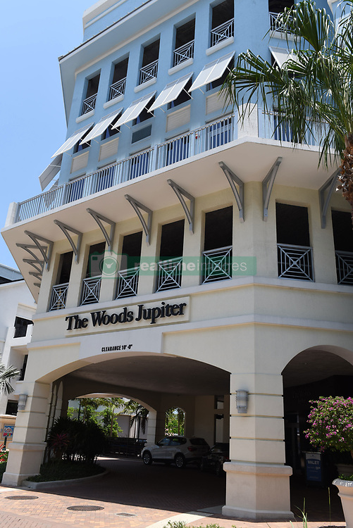 Tiger Woods was arrested driving just a few miles from his Florida home and the town where he owns a sports bar at 3am on Monday morning. Locals say the 41-year-old mult-millionaire golfer is a regular visitor to The Woods, Jupiter, which is a ten minute drive from his home at Hobe Sound, in South Florida. It is not known whether he had been there on the night of his arrest. Woods, who last week expressed his desire to return to competition after his recent back surgery, was headed southbound on Military Trail, south of Indian Creek Parkway, when police said he was seen driving erratically. Cops said he was 'arrogant' after being pulled over. It is not known if he was alone in his 2015 Mercedes or if he was under the influence of drugs or alcohol. In August 2015, he opened a restaurant at Harbourside Place, which is a modern upscale sports bar. It boasts of being a place to 'celebrate like a champion.' The 14-time major champion has not played since he withdrew from the Dubai Desert Classic on Feb. 3. Woods, who has earned more than $110 million on Tour with 79 victories since 1996, has played in just one event this year and pulled out of The Masters. Woods' clean-cut image came apart on Thanksgiving night 2009 when then-wife Elin Nordegren chased him out of their $2.4 million Florida mansion with a golf club after learning of his serial cheating. Woods crashed his car, opening the floodgates of stories about his wild sexcapades. He eventually entered rehab for sex addiction. Woods and Nordegren's divorce was finalized in 2010. 29 May 2017 Pictured: The Woods Jupiter. Photo credit: Michele Eve Sandberg / MEGA TheMegaAgency.com +1 888 505 6342