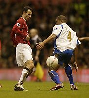 Photo: Aidan Ellis.<br /> Manchester United v Portsmouth. The FA Cup. 27/01/2007.<br /> United's Ryan Giggs nips the ball away from pompey's Glenn Johnson