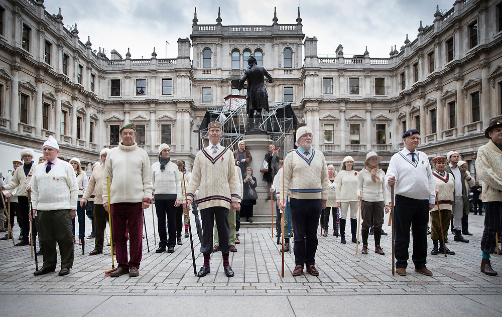 """© Licensed to London News Pictures. 09/11/2018. London, UK.  To mark Remembrance Day, the """"Unshrinkables"""" practice their drill in the Royal Academy of Arts Courtyard. At the outbreak of WW1 in 1914, the original members of the United Arts Rifles – a volunteer force comprised of artists from the Chelsea Arts Club – responded to a call to duty. The group didn't have uniforms, so they bought their own """"unshrinkable"""" white woollen jumpers and hats, and drilled using wooden planks and broomsticks instead of guns. They paraded in the courtyard of the Royal Academy, and were given use of some of the galleries as a mess. The group has been in existence since 1914, and each Remembrance Day the members gather together to parade in the courtyard of The Royal Academy. Photo credit: Peter Macdiarmid/LNP"""