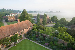 View of the farm buildings, library and Purple Border from the Tower at dawn