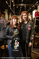 Alex Platt and Hannah Smith of the Black Arrow Moto Gear company of Tasmania (Hobart, Australia) that features all women's motorcycling clothing and gear at the Intermot International Motorcycle Fair. Cologne, Germany. Friday October 5, 2018. Photography ©2018 Michael Lichter.
