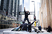 Demonstrators move through Downtown Minneapolis reacting to the trial verdict that former Minneapolis police officer Derek Chauvin was found guilty on all counts in Minneapolis, Minnesota, on Tuesday, April 20, 2021.