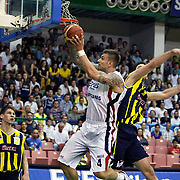 Efes Pilsen's Mario KASUN (C) and Fenerbahce Ulker's Gasper VIDMAR (L) during their Turkish Basketball league Play Off Final fifth leg match Efes Pilsen between Fenerbahce Ulker at the Ayhan Sahenk Arena in Istanbul Turkey on Sunday 30 May 2010. Photo by Aykut AKICI/TURKPIX