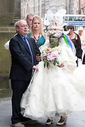 Elaine Davidson, the world's most pierced woman, got married in Edinbugh to Douglas Watson. The happy couple walk down High Street..