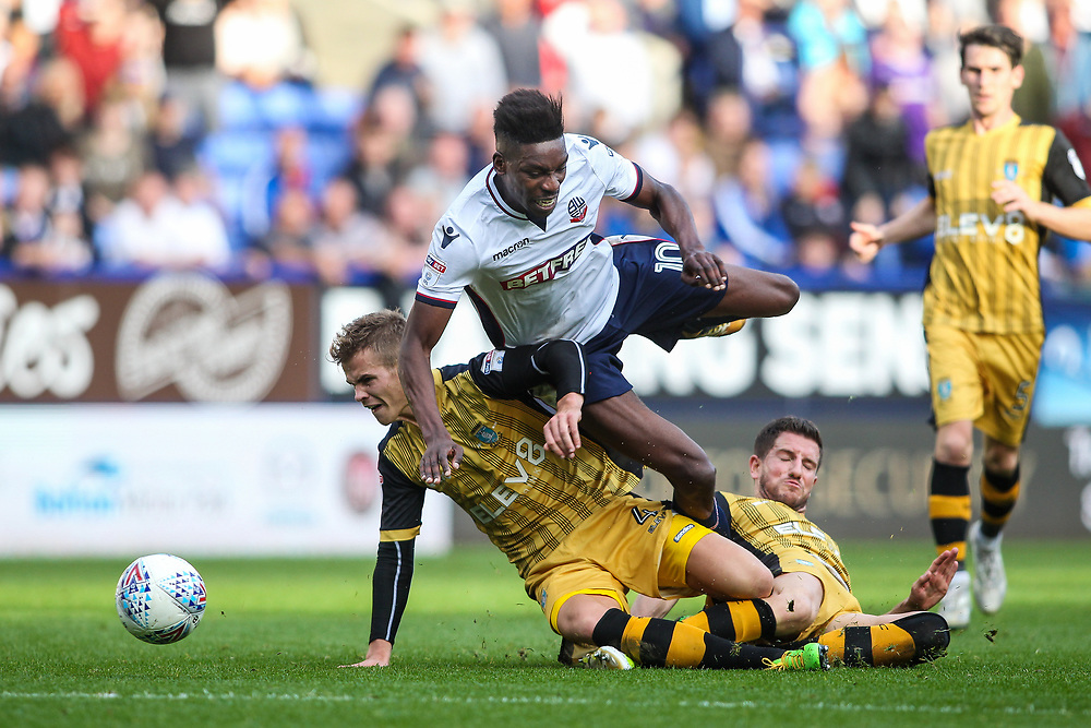 Bolton Wanderers'  Sammy Ameobi competing with Sheffield Wednesday's Sam Hutchinson and Sheffield Wednesday's Joost van Aken <br /> <br /> Photographer Andrew Kearns/CameraSport<br /> <br /> The EFL Sky Bet Championship - Bolton Wanderers v Sheffield Wednesday - Saturday 14th October 2017 - Macron Stadium - Bolton<br /> <br /> World Copyright © 2017 CameraSport. All rights reserved. 43 Linden Ave. Countesthorpe. Leicester. England. LE8 5PG - Tel: +44 (0) 116 277 4147 - admin@camerasport.com - www.camerasport.com