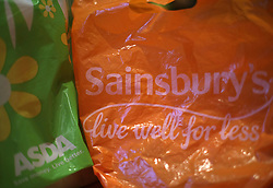 Shopping bags from Asda and Sainsbury's, as the two supermarket chains are in advanced talks over a merger which would create a new supermarket giant.