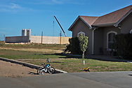 Frack job next to a homes in Midland, Texas, in the Permian Basin.