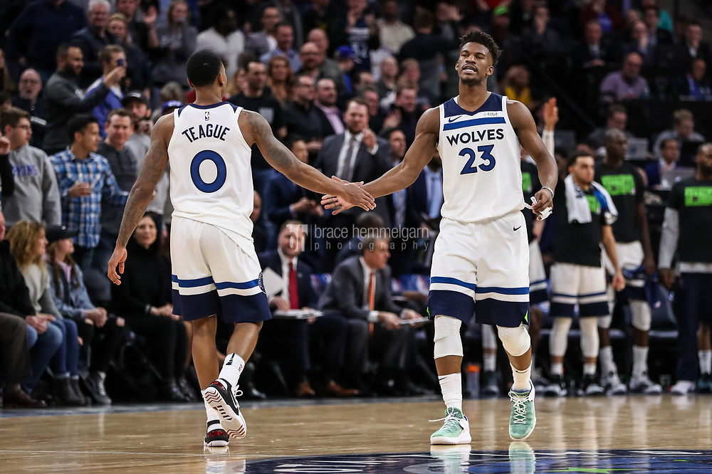 Feb 15, 2018; Minneapolis, MN, USA; Minnesota Timberwolves guard Jimmy Butler (23) celebrates with guard Jeff Teague (0) during the fourth quarter against the \e at Target Center. Mandatory Credit: Brace Hemmelgarn-USA TODAY Sports