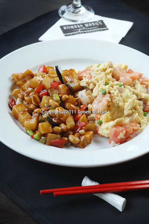 Shanghai scrambled eggs with Chinese sausage and Kung Pao potato at Howard Wang's Uptown China Brasserie on May 28, 2011..Robert W. Hart/Special Contributor
