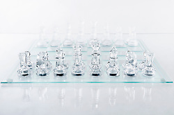Glass chess pieces on board, Bavaria, Germany